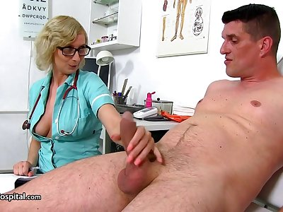 Old lady Nurse Give Her Patient A Nice Ha - heavy-breasted