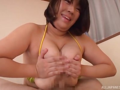 Big ass Asian mom shakes tits on a big dick then fucks