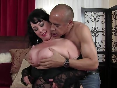 Mature brunette not far from titanic tits is getting her steadily dose of fuck from a black mendicant